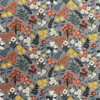 Tela algodón campo de flores azul claro